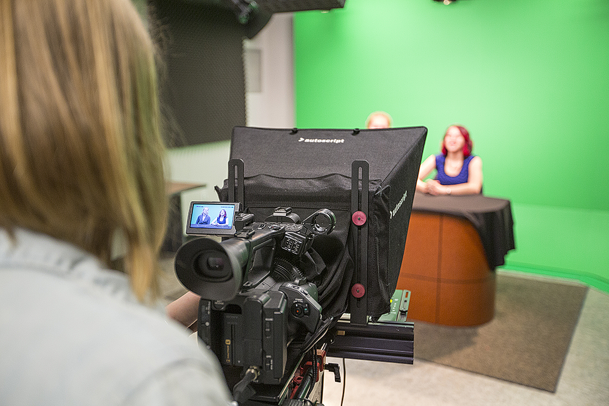 Students in a Digital Video Class use the TV studio in the basement of Carpenter Hall