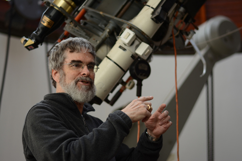 Speaker Brother Guy Consolmagno, SJ with a telescope